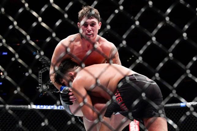 Darren Till defends a takedown by Kelvin Gastelum in their UFC fight