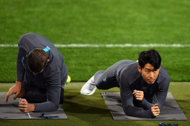 Heung-min Son and Toby Alderweireld warm up ahead of Tottenham's game against Red Star Belgrade