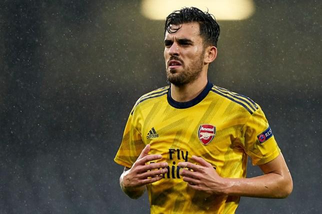 Dani Ceballos plays for Arsenal as the rain falls during a Europa League game