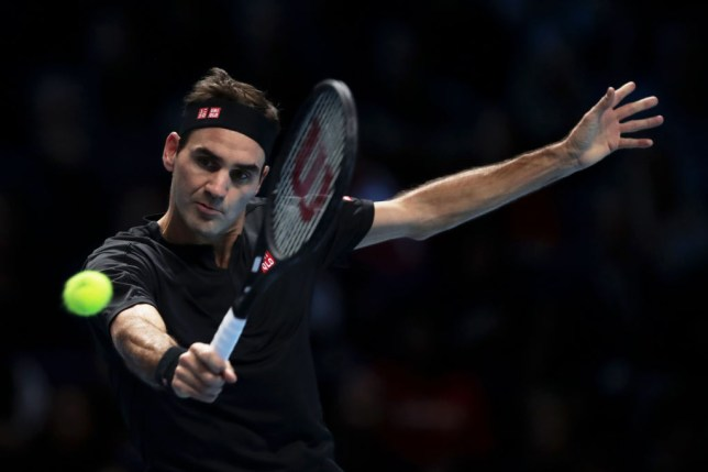 Roger Federer hits a backhand during his win over Novak Djokovic at the ATP FInals