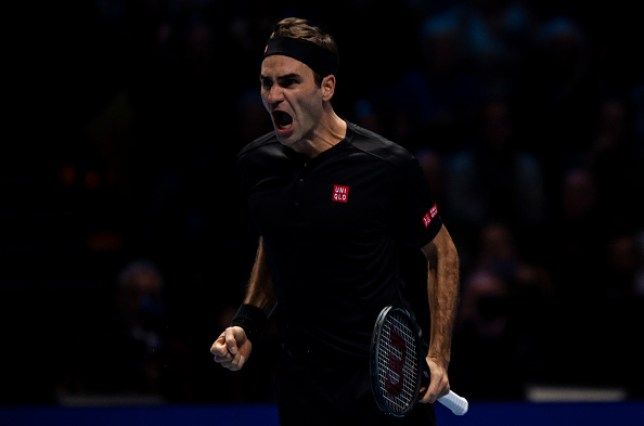 Roger Federer roars after beating Novak Djokovic at the ATP Finals