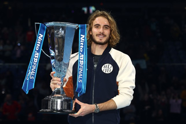 Stefanos Tsitsipas holds the ATP Finals trophy aloft after his win over Dominic Thiem