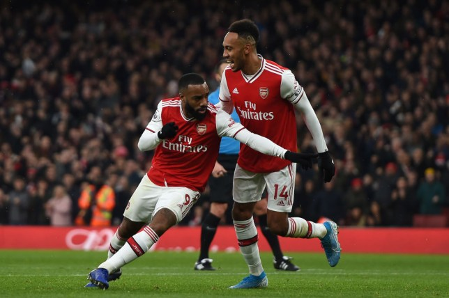 Alexandre Lacazette of Arsenal celebrates a goal with Arsenal teammate Pierre-Emerick Aubameyang