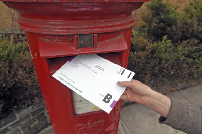 A postal vote being put into a post box