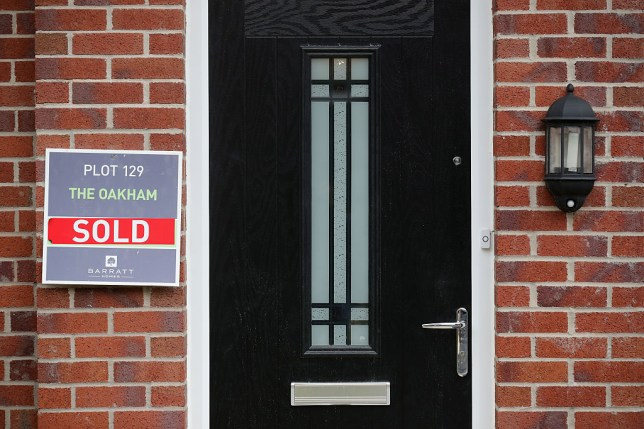 A front door with a sold sign outside