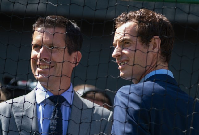 Tim Henman stands next to fellow ATP Cup team member Andy Murray