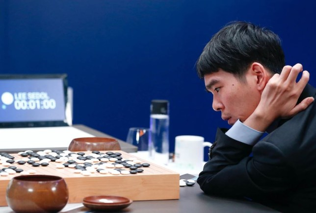 Lee Sedol playing against Google's AI DeepMind in 2016 (Getty)