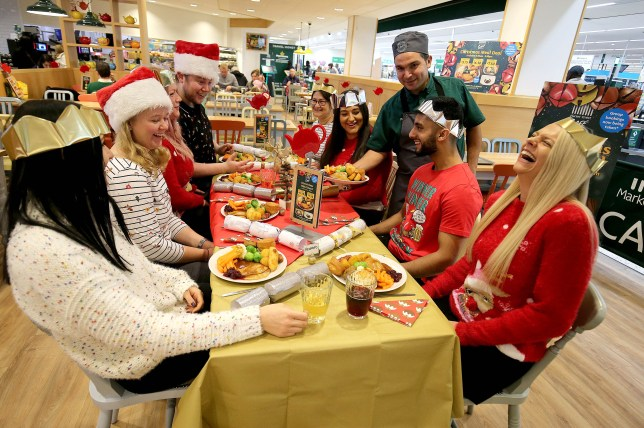 People enjoying a Christmas party at the Morrisons cafe