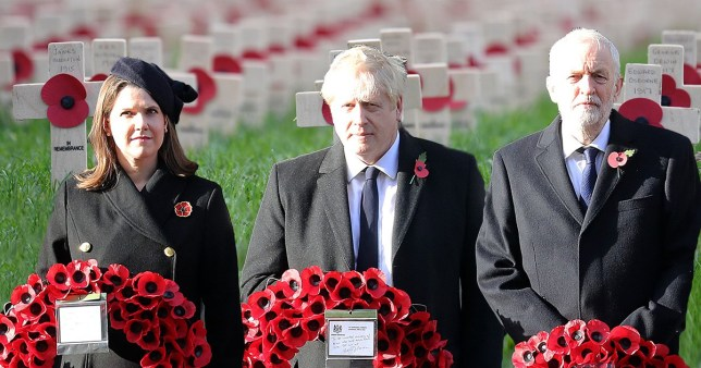Picture of Liberal Democrat leader Jo Swinson, Conservative Party leader Boris Johnson and Labour leader Jeremy Corbyn laying wreaths on a backdrop of war graves