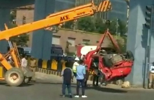 This terrifying video shows the moment a car plummeted 20ft from a motorway flyover into a crowd of people - killing one woman and injuring six others. See SWNS story SWOCcrash. Shocking CCTV shows how the car lost control and flew off the flyover - landing on top of a group of people standing beneath the road. Footage from the scene, in Hyderabad, Telangana, southern India shows a group of pedestrians waiting at a bus stop at around 1pm yesterday (Saturday) afternoon. A red Volkswagen can then be seen smashing through safety barriers and landing right where the crowd of people are stood. Some people managed to spot the car heading towards them and were able to escape without injury. The six people who were injured were rushed to hospital for treatment. According to local police, the car is understood to have been travelling at more than 100km/ph when it crashed - on a road with a 40km/ph speed limit.