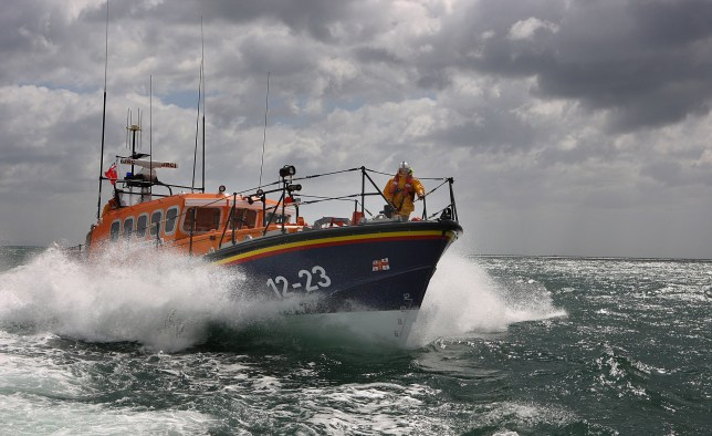 Children among 13 migrants rescued from boat in English Channel