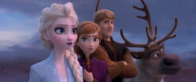"""This image released by Disney shows Elsa, voiced by Idina Menzel, from left, Anna, voiced by Kristen Bell, Kristoff, voiced by Jonathan Groff and Sven in a scene from the animated film, """"Frozen 2."""" (Disney via AP)"""
