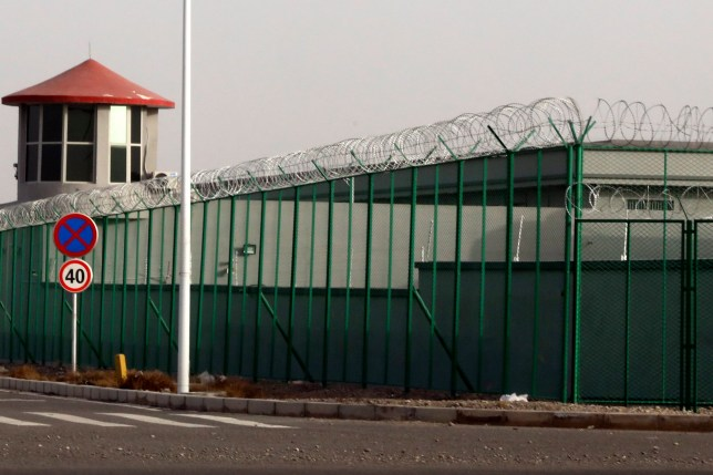 "FILE.- In this Monday, Dec. 3, 2018, file photo, a guard tower and barbed wire fences are seen around a section of the Artux City Vocational Skills Education Training Service Center in Artux in western China's Xinjiang region. This is one of a growing number of internment camps in the Xinjiang region, where by some estimates over 1 million Muslims have been detained, forced to give up their language and their religion and subject to political indoctrination. Confidential documents, leaked to a consortium of news organizations, lay out the Chinese government's deliberate strategy to lock up ethnic minorities to rewire their thoughts and even the language they speak. One of the documents says that internment camps ??? such as the one in Artux ??? are to install guard towers, as well as other security measures to ""prevent escapes"". (AP Photo/File)"