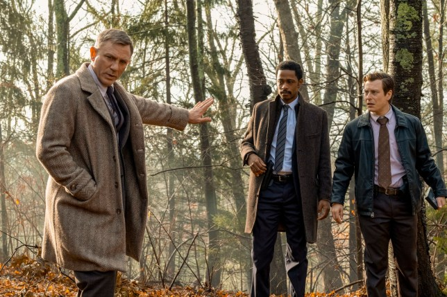 """This image released by Lionsgate shows Daniel Craig, from left, Lakeith Stanfield and Noah Segan in a scene from """"Knives Out."""" (Claire Folger/Lionsgate via AP)"""