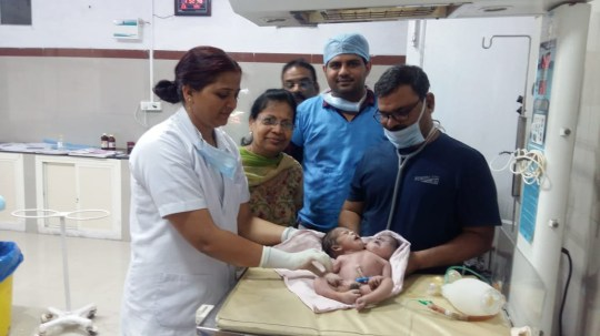 "Baby born with two heads and three hands baffles doctors in India A 21-year-old woman delivered a baby with two heads and three hands, sending doctors of the state-run facility into a tizzy in central India. Babita Ahirwar, a resident of Basauda village in Vidisha district of Madhya Pradesh, delivered the baby around 7:30 am on November 23 through C-section. Babita was married to Jaswant Ahirwar around one and a half years ago. The couple which was eagerly waiting to welcome their first baby was devastated after seeing the infant born with a deformity. ""It was a mixed feeling when the nurses handed over the baby to me. Initially, I thought it was a twin, but when the nurses removed the towel, I was shocked to see our firstborn with two heads and three hands. All we wanted was a normal and healthy baby, but the almighty wanted to punish us this way. I don't know why,"" said new mom Babita told Newslions. Dr Surendra Sonkar of Vidisha Sadar hospital said: ""On Saturday morning around 7:30 am, we facilitated the delivery of a baby through C-section. The baby had two heads and three hands. The third hand had two palms attached to it. ""There is only one heart visible in the newborn. This is a very rare condition and this is the first time. I have come across such a case in my career,"" he said. ""We had initially kept the baby in the ICU, but we thought it was better to refer them to a better-equipped facility in Bhopal,"" he added. At present, the baby is undergoing treatment at Bhopal's Hamidi Medical College and Hospital. Video: Youtube Link: https://youtu.be/7wqSEKcRZsA NOTE: Clean file available on request."