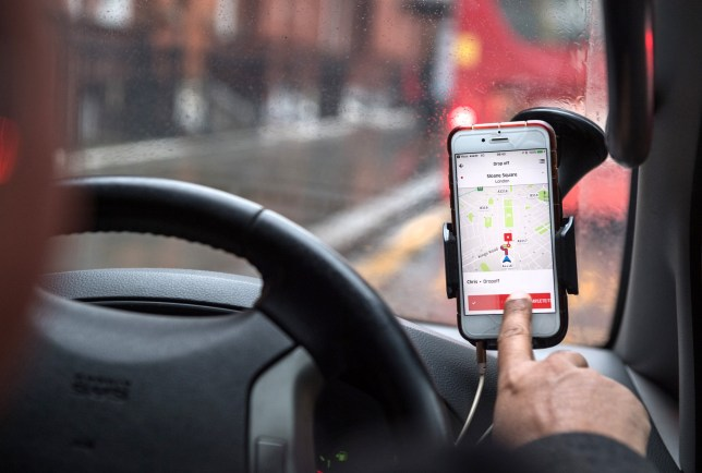 A driver uses the Uber Technologies Inc. ride-hailing service smartphone
