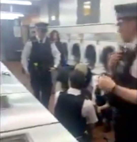 Picture: :@ Julian Marfo Police officers in launderette