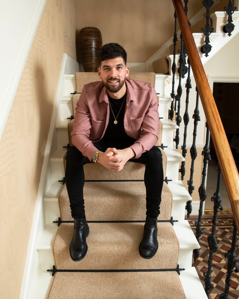 Mesha, who has ulcerative colitis, sits on the stairs at his home in Dorset