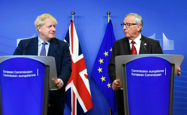 BRUSSELS, BELGIUM - OCTOBER 17: European Comission President Jean-Claude Juncker (R) makes a speech during the press conference with the attendance of British Prime Minister Boris Johnson (L) in Brussels, Belgium on October 17, 2019. (Photo by Dursun Aydemir/Anadolu Agency via Getty Images)