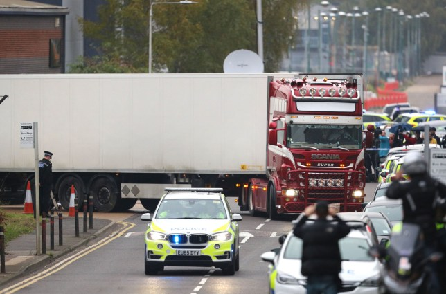 The container lorry where 39 people were found dead inside leaves Waterglade Industrial Park in Grays, Essex, heading towards Tilbury Docks under police escort. PA Photo. Picture date: Wednesday October 23, 2019. Early indications suggest there 38 are adults and one teenager, police said. The lorry is from Bulgaria and entered the country at Holyhead, North Wales, one of the main port for ferries from Ireland. See PA story POLICE Container. Photo credit should read: Aaron Chown/PA Wire