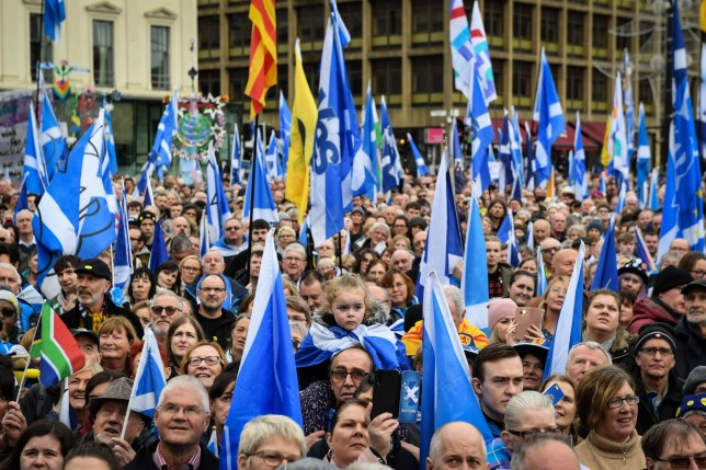 Paricipants hold a variety of flags as they attend a rally calling for Scottish independence in Glasgow, on November 2, 2019. (Photo by ANDY BUCHANAN / AFP) (Photo by ANDY BUCHANAN/AFP via Getty Images)
