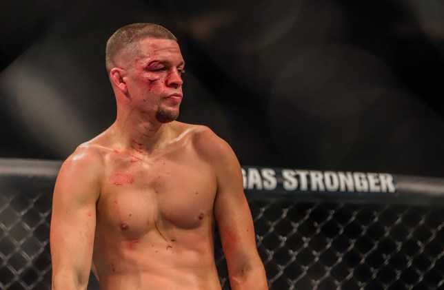 Nate Diaz looks on during a UFC fight with blood pouring from two cuts around his eye