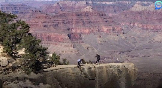 Moment woman nearly falls into Grand Canyon while taking photo