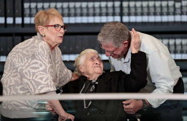 Greek World War II rescuer Melpomeni Dina (C) reacts as she is reunited with holocaust survivors Yossi Mor (R) and his sister Sarah Yanai, whom she helped escape in 1943, at the Hall of Names at the Yad Vashem Holocaust Memorial museum in Jerusalem on November 3, 2019. (Photo by Emmanuel DUNAND / AFP) (Photo by EMMANUEL DUNAND/AFP via Getty Images)
