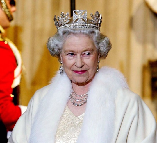 LONDON, UNITED KINGDOM - NOVEMBER 13: Queen Elizabeth II Smiling As She Arrives At The Palace Of Westminster For The State Opening Of Parliament. The Queen Is Wearing A Diamond Crown Known As The State Diadem Made For The Coronation Of George Lv. She Is Wearing An Embroidered Cream Satin Dress Covered With A Fur-trimmed Robe. (Photo by Tim Graham Picture Library/Getty Images)