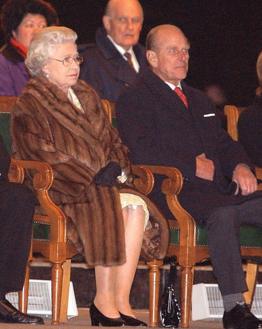 Britain's Queen Elizabeth II and her husband, the Duke of Edinburgh, sit on a stage to watch performances by dancers and musicians outside the Legislative Assembly building in Winnipeg, Manitoba, during their two week Royal Golden Jubilee visit to Canada.