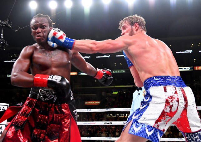 logan paul punching ksi during their boxing rematch