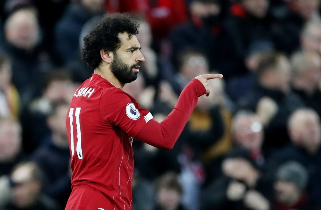 Mohamed Salah points to his team-mates after scoring for Liverpool