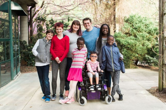 Dad Lee Dingle pictured with his wife Shannon and six kids, some of whom have disabilities, before he died at the beach