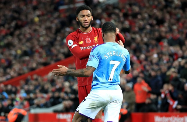 Liverpool's Joe Gomez and Manchester City's Raheem Sterling clash during the Premier League match at Anfield