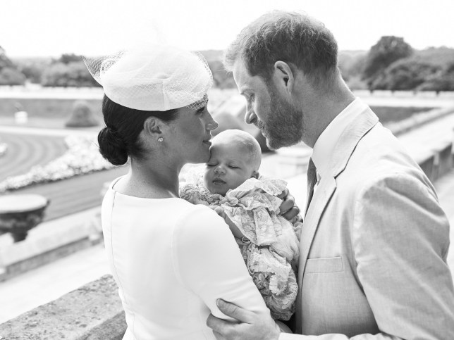 """TOPSHOT - This official handout Christening photograph released by the Duke and Duchess of Sussex shows Britain's Prince Harry, Duke of Sussex (R), and his wife Meghan, Duchess of Sussex holding their baby son, Archie Harrison Mountbatten-Windsor at Windsor Castle with the Rose Garden in the background, west of London on July 6, 2019. - Prince Harry and his wife Meghan had their baby son Archie christened on Saturday at a private ceremony. (Photo by Chris ALLERTON / SUSSEXROYAL / AFP) / XGTY / RESTRICTED TO EDITORIAL USE - MANDATORY CREDIT """"AFP PHOTO / SUSSEXROYAL / CHRIS ALLERTON"""" - NO MARKETING NO ADVERTISING CAMPAIGNS - NO COMMERCIAL USE - NO THIRD PARTY SALES - RESTRICTED TO SUBSCRIPTION USE - NO CROPPING OR MODIFICATION - NOT FOR USE AFTER DECEMBER 31, 2019 - DISTRIBUTED AS A SERVICE TO CLIENTS / (Photo credit should read CHRIS ALLERTON/AFP via Getty Images)"""