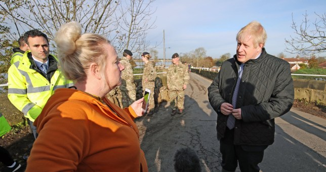 Prime Minister Boris Johnson talks to a woman during a visit to Stainforth, Doncaster, to see the recent flooding. PA Photo. Picture date: Wednesday November 13,2019. Thirty-five flood warnings are still in place across England as the Prime Minister has urged people in affected areas to heed the warnings of emergency services. See PA story WEATHER Rain . Photo credit should read: Danny Lawson/PA Wire