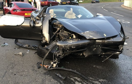The grey Ferrari 458 following the collision. A grey Ferrari 458, costing up to ?200,000, and a red Porsche 911, worth around ?100,000, were involved in a crash while speeding inSheffield, South Yorks, on May 20 last year. See SWNS story SWLEcars. .These shocking pictures show the wreckage of two supercars which were involved in a horrific high-speed smash. The devastating collision involved a grey Ferrari 458, costing up to ?200,000, and a red Porsche 911, worth around ?100,000. Ferrari driver Carl Hartley, 32, was speeding in Sheffield, South Yorks, on May 20 last year when he lost control of his vehicle. His car smashed into fellow speeding motorist Henry Hibbs, 27, who was in his Porsche and suffered minor injuries.