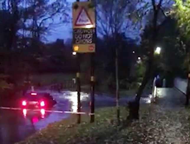 A Mercedes was abandoned after a driver tried and failed to cross a notorious flooding flashpoint as Birmingham was deluged by hours of rain. The car was almost completely submerged at the Ford on Green Road in Hall Green - despite red flashing signs saying ?Caution, do not cross? and a cordon.