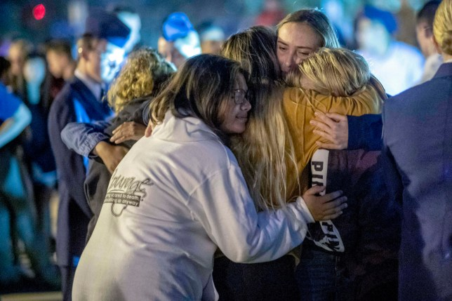 People hug each other during a vigil for the Saugus High School mass shooting