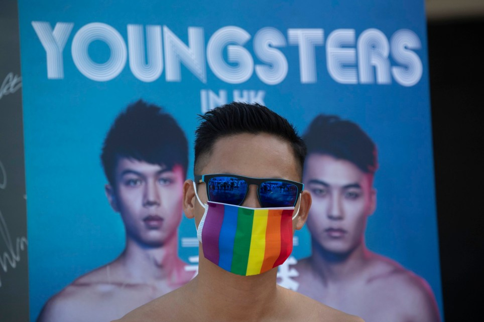 A participant wears a rainbow mask as he joins the gay pride rally in Hong Kong, Saturday, Nov. 16, 2019. Rebellious students and anti-government protesters abandoned their occupation of nearly all of Hong Kong's universities Saturday after a near weeklong siege by police, but at least one major campus remained under control of demonstrators. (AP Photo/Ng Han Guan)