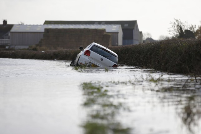 Mandatory Credit: Photo by Xinhua/REX (10472791c) Car in floodwater on the road leading to Fishlake village Flooding in Doncaster, UK - 11 Nov 2019 The British government activated on Saturday an emergency scheme to support local authorities to deal with flood in parts of England after extremely heavy rainfall.