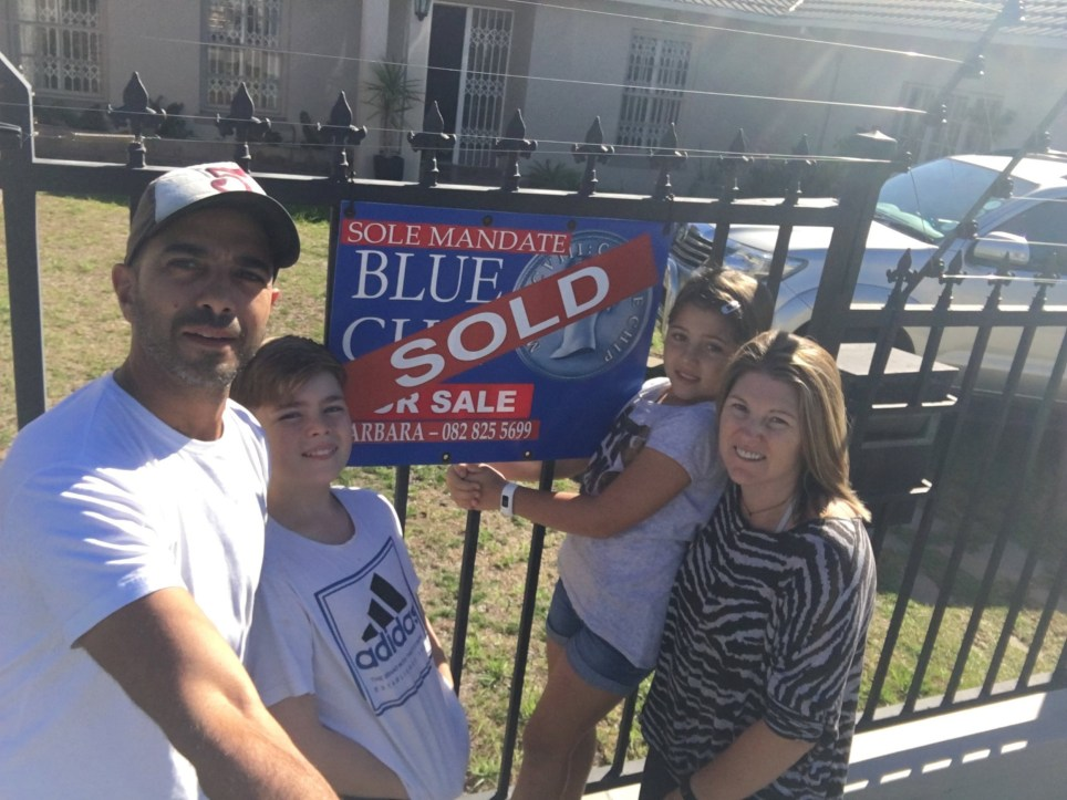 "***EMBARGOED UNTIL 2PM 17/11/19***(L-R) Andre, 45, Rico, 12, Tiana-Mae,10, and Becky, 44, outside the home they sold in Cape Town to fund their trip. Andre Baldeo, 45, and his wife Becky, 44, gave up the rat race, sold their ?350,000 home, and took their two kids Rico, 12, and Tiana-Mae, 10, on a 51,000 miles, 13 country world travel tour. See SWNS story SWOCtravel. A couple bored of the ?9-5 working life rut? quit their jobs and sold their ?350,000 family home to travel the world with their young kids. Stock market trader Andre Baldeo, 45, was happy and healthy but realised he was simply ""going through the motions"" rather than living life to the full. In a bid to show kids , Rico, 12, and Tiana-Mae, 10, there was ""more to life than suburbia"", he convinced wife Becky, 44, to uproot the entire family. They both quit their jobs, sold their belongings and bought a one-way ticket for an 18-month trip of a lifetime."