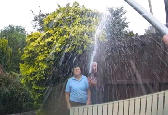 Collect vidio grab Copyright Picture by Andrew Price / View Finder Pictures - Chester. 07 774 611 778. Caption: Barry & Hellynne Lee assaulting neighbour Harold Burrow with water from the hosepipe.. Story Glyn Bellis??? Hosepipe assault on neighbour. See full video from View Finder Pictures..