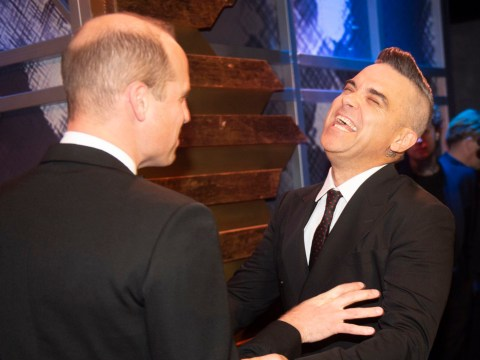 Prince William finds Robbie Williams hilarious as they joke around at Royal Variety Show