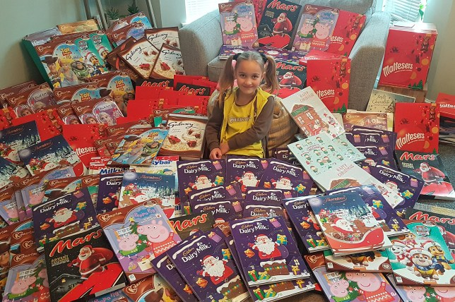 Holly Bonges with her 215 advent calendars she donated to a food bank