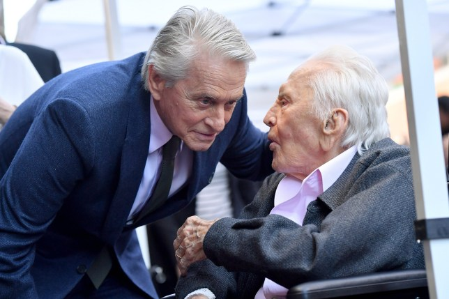 Michael Douglas' father Kirk 'begging and crying' not to have a party for his 103rd birthday