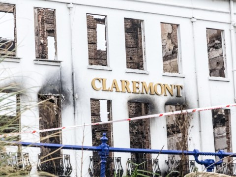 Fire crews remain in place amid concerns over stability of building after huge hotel blaze