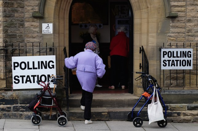 A woman walks into a polling station situated in Saltburn Methodist Church on May 7, 2015 in Saltburn, England.