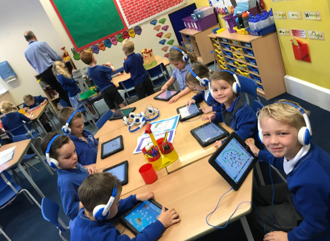 Children at St Mary's Primary School in Twickenham with their new devices