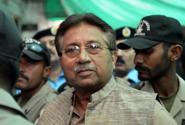 Former Pakistani president Pervez Musharraf (C) is escorted by soldiers as he arrives at an anti-terrorism court in Islamabad, Pakistan. Pakistan's former military ruler Pervez Musharraf on December 24, 2013, is scheduled to face trial for treason over his imposition of emergency rule in 2007, charges he has dismissed as politically motivated. The 70-year-old is expected to appear in person before a specially-convened court in the capital Islamabad, after legal efforts to have the tribunal ruled invalid failed. (FILES) In this photograph taken on April 20, 2013, AFP PHOTO/AAMIR QURESHI/FILESAAMIR QURESHI/AFP/Getty Images